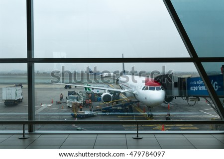 Lima Peru - May 20 : Workers loading an Airplane for an international flight with both personal and business shipping. May 20 2016, Lima Peru.