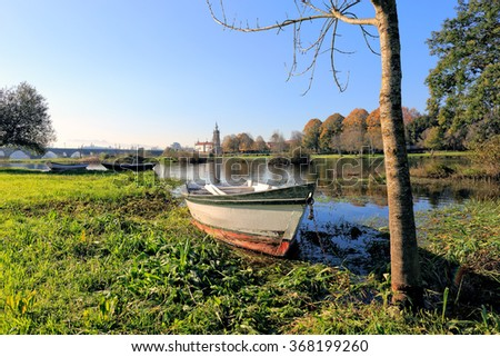 Lima river and medieval city of Ponte de Lima in a beautiful sunny winter day. North of Portugal. - stock photo