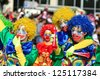 LIMASSOL, CYPRUS - FEBRUARY 26: Unidentified Carnival participants in costumes of a clowns march in Cyprus Carnival Parade on February 26, 2012 in Limassol, Cyprus, established in 16th century - stock photo