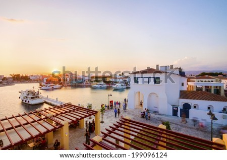 LIMASSOL, CYPRUS - 8 JUNE 2014: First week that the beautiful Marina in Limassol city opened to the public. A view of the modern commercial area where yachts are moored with restaurants and cafes. - stock photo