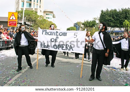 LIMASSOL,CYPRUS-MARCH 6, 2011: Unidentified people in opera phantom costume participates during the carnival parade, established in 16th century, influenced by Venetian traditions.