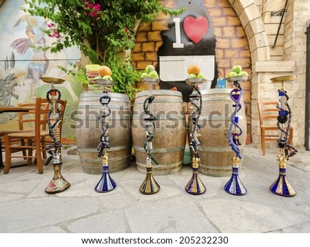 LIMASSOL, CYPRUS - 30 MAY 2014: Six shisha, aka nargile or hookah at a restaurant with fruit on top. A very middle eastern custom. - stock photo