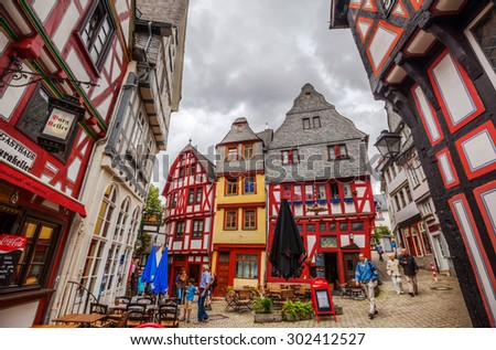 LIMBURG AN DER LAHN, GERMANY - JULY 25, 2015: old town of Limburg with unidentified people. Limburg is well known for its St Georgs Cathedral and its full set of nearly unscathed medieval buildings