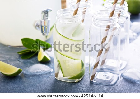 Lime and cucumber lemonade in small bottles