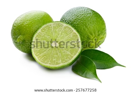 lime and leaves isolated on white - stock photo