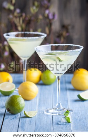 Lime and lemon martini with vodka in the cocktail glasses - stock photo