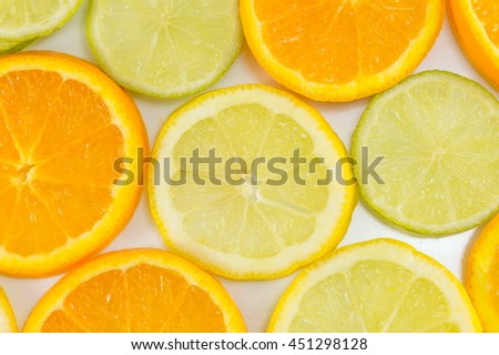 Lime fruit and orange slices making background pattern