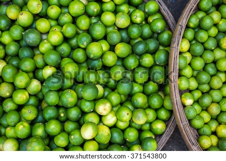 Lime fruits on the big plate on farmers market