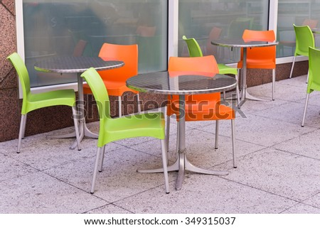 Lime Green and Orange Chairs and Tables at Outdoor Restaurant