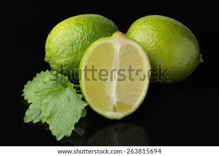 lime isolated on black - stock photo