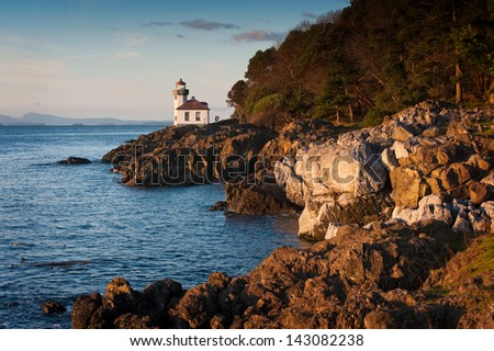 Lime Kiln Lighthouse. A beautiful little lighthouse on San Juan Island in the Pacific Northwest area of Washington State, USA. - stock photo