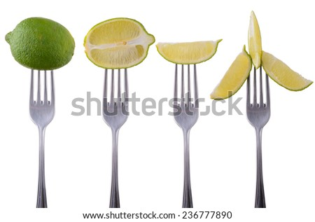 Lime on a fork isolated on white background closeup