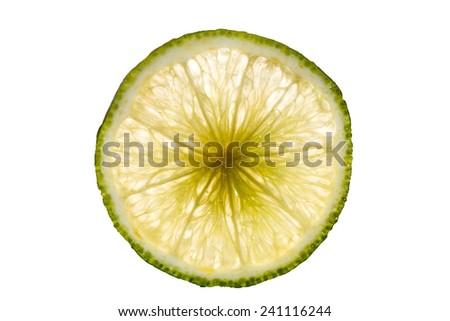 lime slice isolated on white background back lighted - stock photo