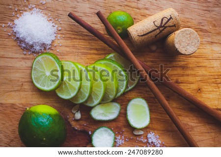 Lime slices, sugar, cork and Chinese sticks - stock photo