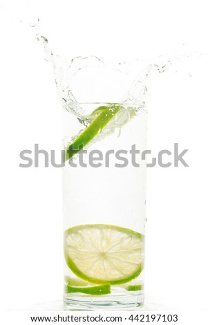 Lime splash in the glass on isolated white