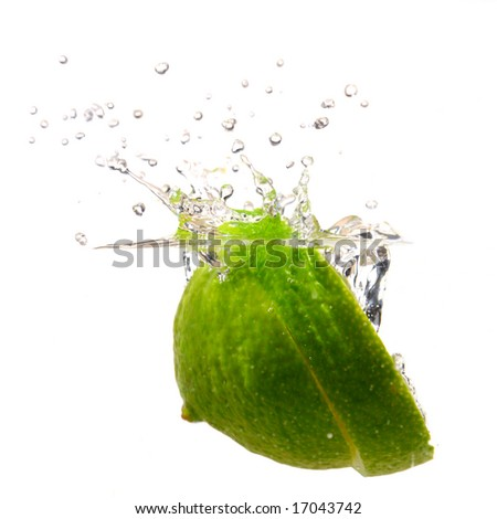 Lime splashing into water studio isolated on white background