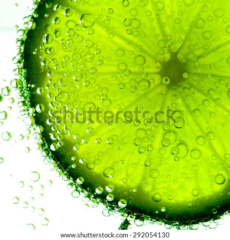 lime with bubbles isolated on white. studio shot