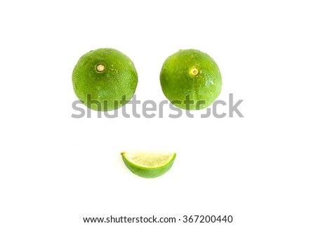 Limes and leaves isolated on white background - stock photo