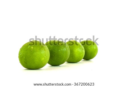 Limes and leaves isolated on white background