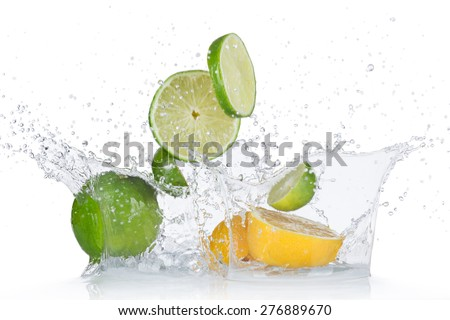 Limes and lemons with water splash isolated on white - stock photo