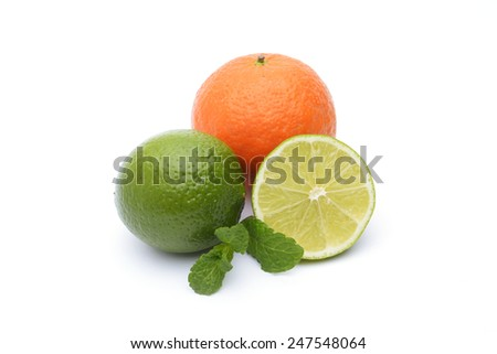 Limes and tangerines on white background - stock photo
