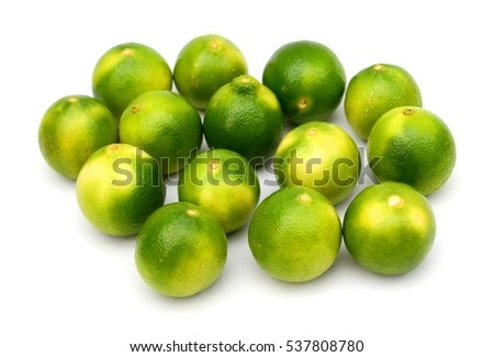 Limes close up on white background