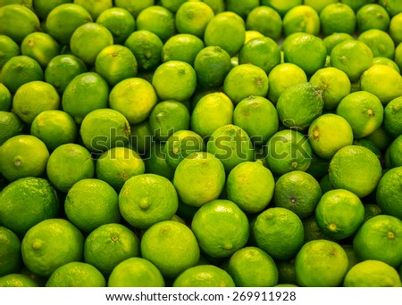 limes pile up at a market