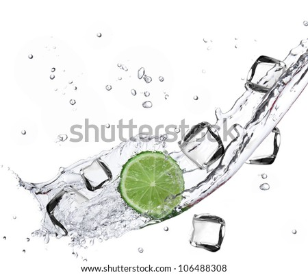 Limes with Ice cubes and water splashing - stock photo