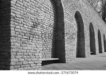 Limestone fortress wall in Tallinn, Estonia. Black and white. - stock photo