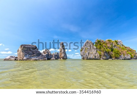 Limestone mountains oceanfront building with high mountains up like giant bonsai located on the sea creating spectacular natural beauty of Vietnam sea - stock photo