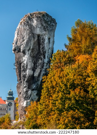 Limestone rock formation called Bludgeon of Hercules or Maczuga Herkulesa Renaissance Castle in Pieskowa Skala in the area of Krakow-Czestochowa Upland, Poland - stock photo