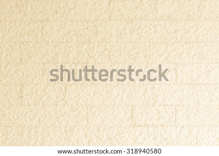 Limestone rock slab tile wall texture patterned background in light pastel cream yellow beige color tone: Rustic aged rough matte  marble slate wall textured detail backdrop in creme toned colour - stock photo