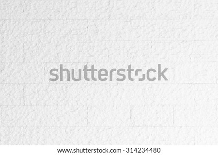 Limestone rock slab tile wall texture patterned background in light pastel white color tone: Rustic aged rough matte  marble slate wall textured detail backdrop in white creme toned colour - stock photo