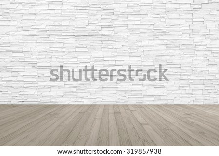 Limestone rock tile wall backdrop in light white grey color tone with wooden floor in sepia brown colour: Grunge vintage style room with rustic stone wall pattern background and wood flooring     - stock photo