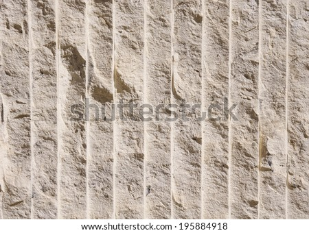 Limestone with many vertical lines in sunny day  - stock photo