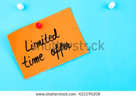 Limited Time Offer written on orange paper note pinned on cork board with white thumbtack, copy space available - stock photo