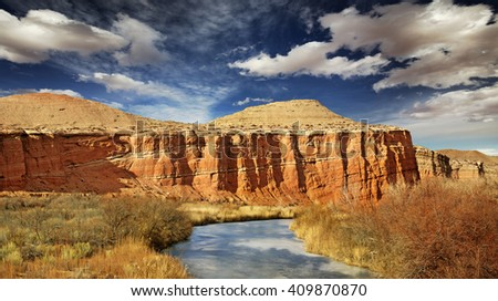 limpid creek flowing through sandstone formations - stock photo