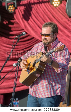 LiNCOLN, CA - June 17: Dan Tyminski performs with Alison Krauss and Union Station at Thunder Valley Casino Resort in in Lincoln, California on June 17, 2015 - stock photo