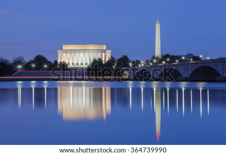 Lincoln Memorial and the Washington monument, DC landmarks, illuminated in the blue hour and reflecting in the water of the Potomac River. - stock photo