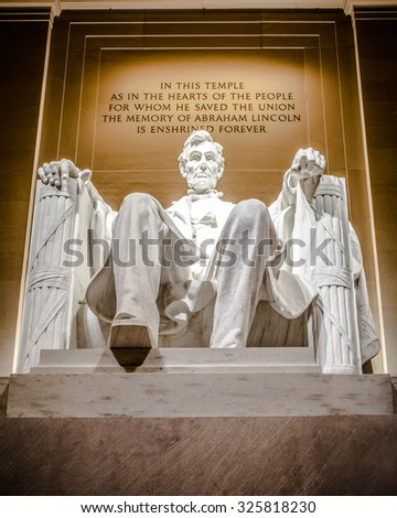 Lincoln Memorial statue of Abraham Lincoln seen at night - stock photo