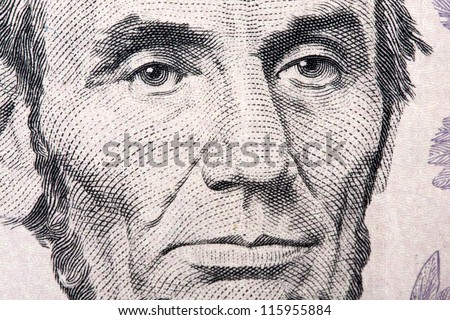 Lincoln on the five dollar bill - stock photo