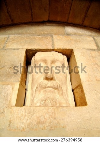 Lincoln, UK - April 9, 2015: Architectural detail of basrelief depicting Jesus Christ at Lincoln Cathedral, Lincolnshire, England.