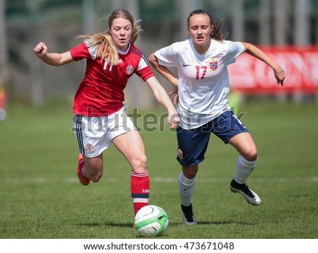 LINDABRUNN, AUSTRIA - APRIL 13, 2015: Freja Kjaersig Sunesen (#11 Denmark) and Andrea Wilmann (#17 Norway) fight for the ball during a UEFA women's U17 qualifying game.