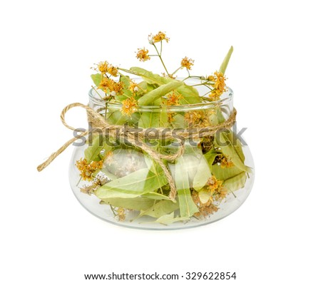 linden flower in a transparent jar isolated on white background - stock photo
