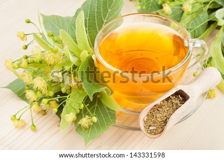 linden flowers and cup of healthy tea, herbal medicine