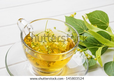 linden tea on a white table - stock photo