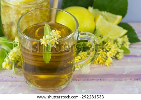 Linden tea with lemon decorated with lime flower served with honeycomb