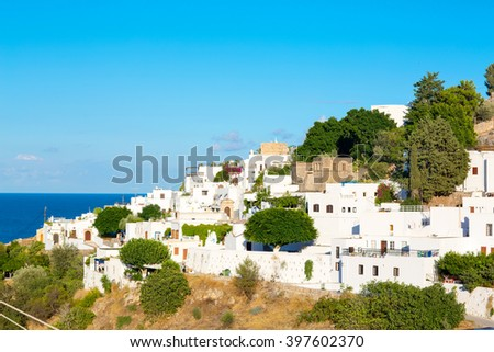 Lindos with the castle above on the Greek Island of Rhodes - stock photo