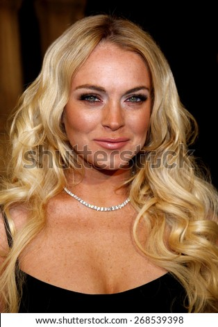 "Lindsay Lohan attends the Los Angeles Premiere of ""Cloverfield"" held at the Paramount Pictures Lot in Hollywood, California, United States on January 16, 2008.  - stock photo"