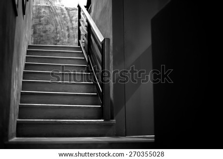 Line from light and shade of wooden stair in the restaurant - stock photo